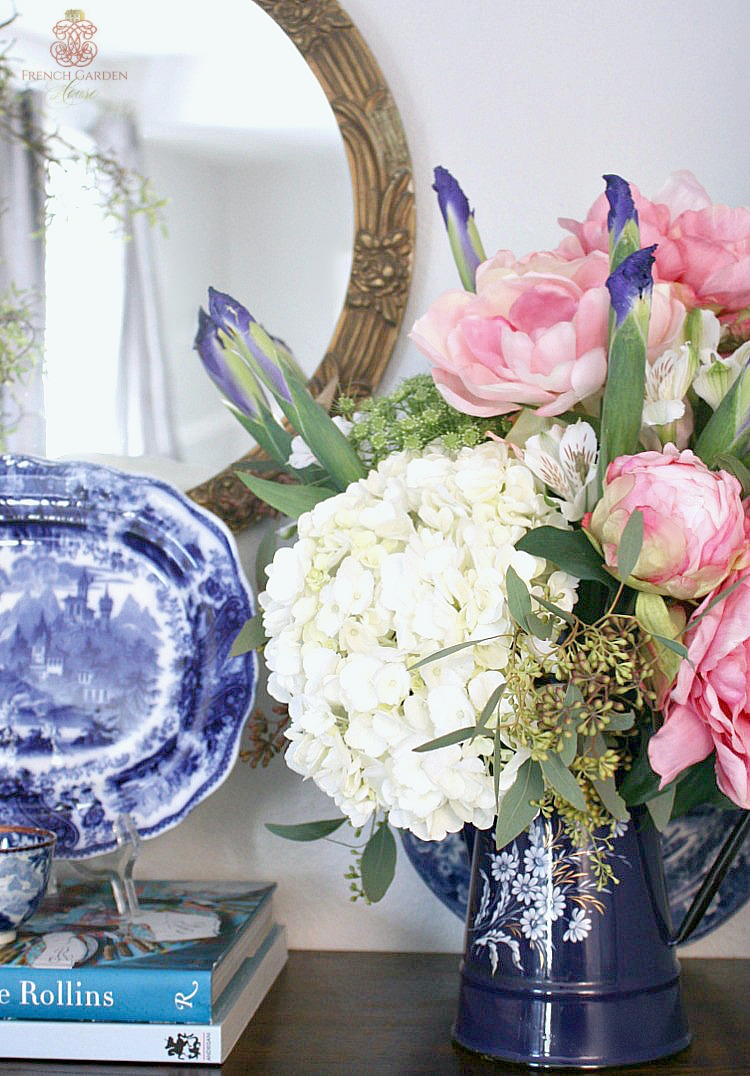 antique french enamel pot filled with hydrangea, pink peonies