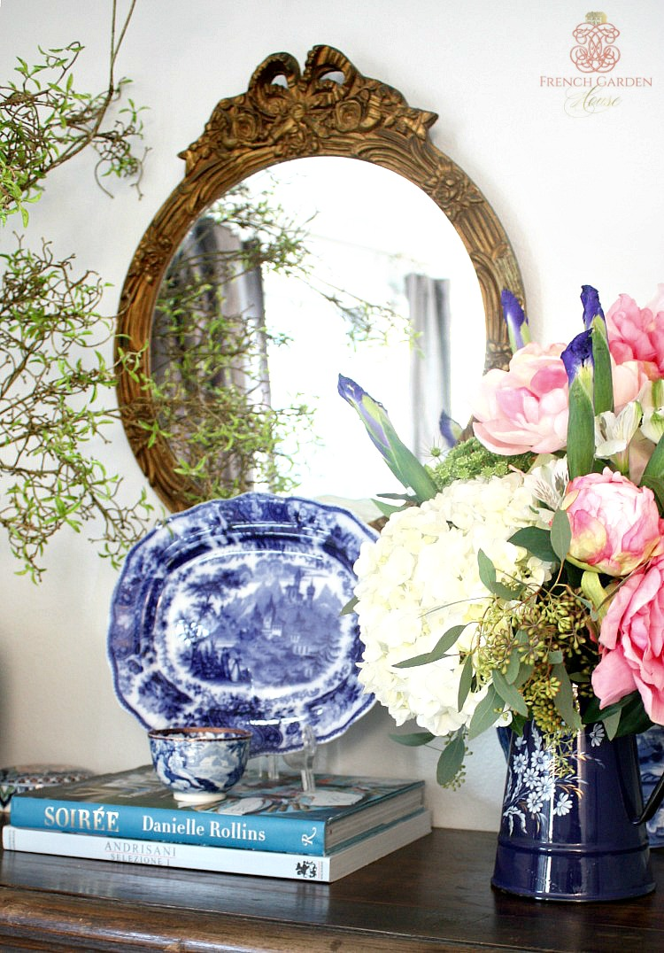 mantel decorated with pink peonies in French enamelware