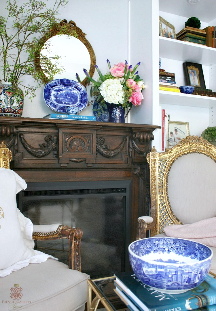 sitting area in master bedroom with built ins and french antique gilt chairs