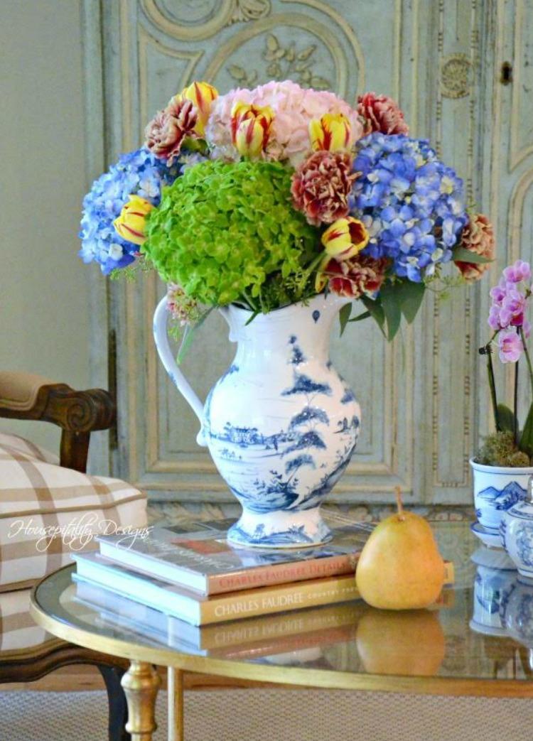 green and blue hydrangeas in delft vase