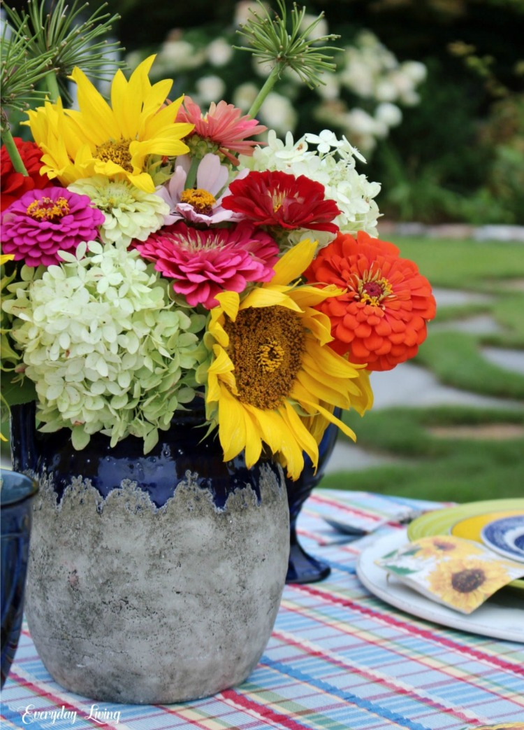 summer sunflowers in an antique French confit pot