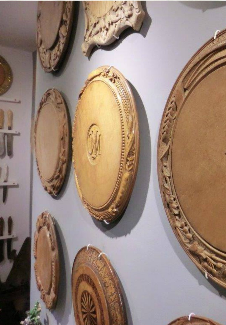 display of wall hung museum quality bread boards