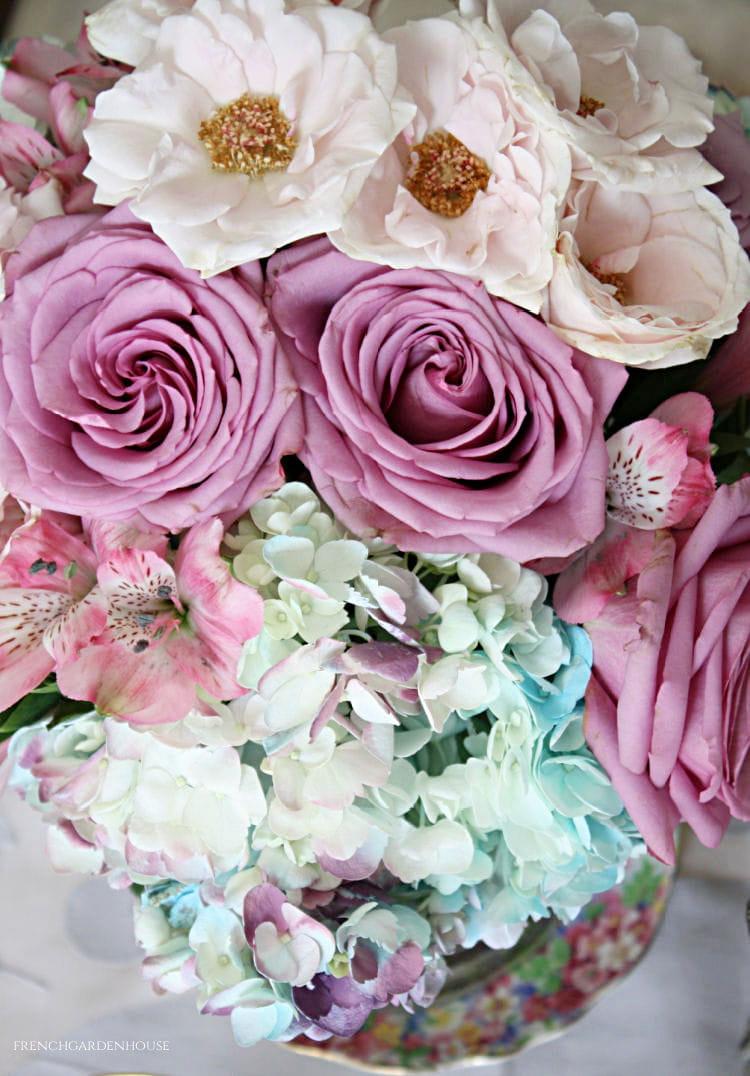 pink roses blue hydrangeas