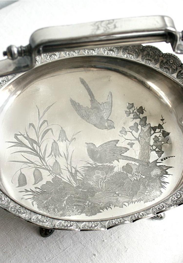 Silver basket bird detail
