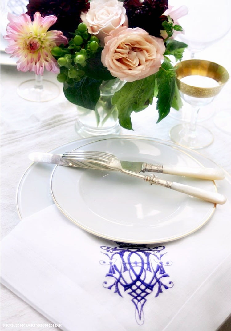 white table setting with flowers