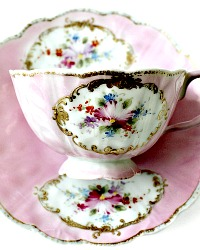 Antique Hand Painted Porcelain Pink Luster Tea Cup and Saucer Set