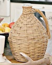 Antique French Country Demi John in Wicker