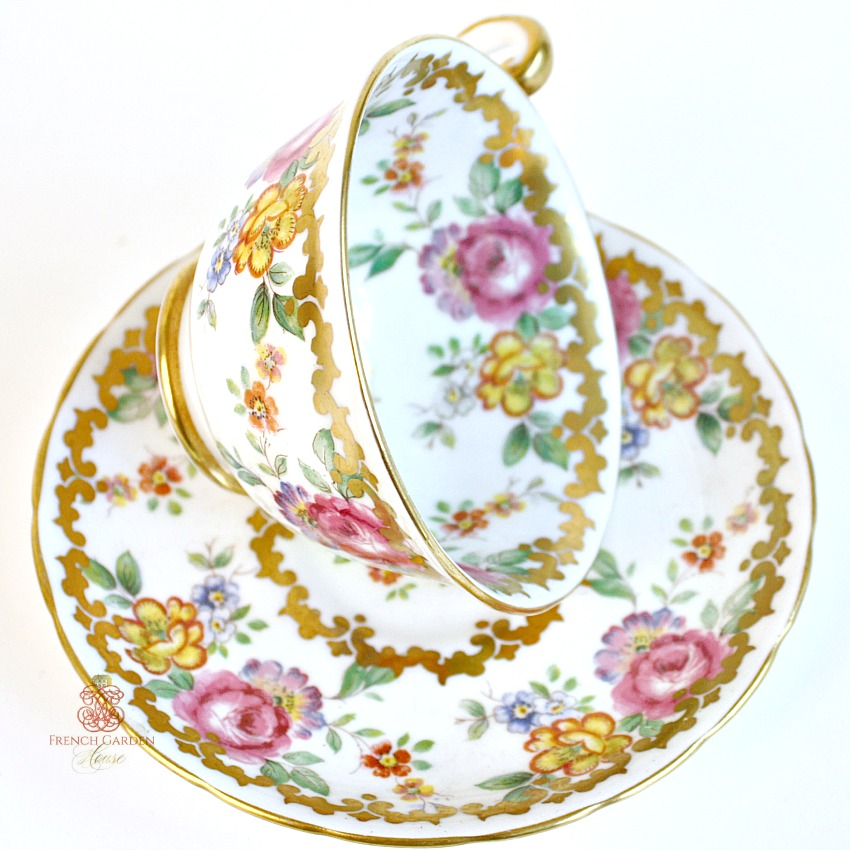 Royal Chelsea Tea Cup And Saucer Gilt Pink Roses