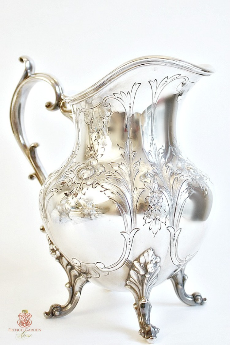 Exceptional Hand Chased Silver Plated Water Pitcher